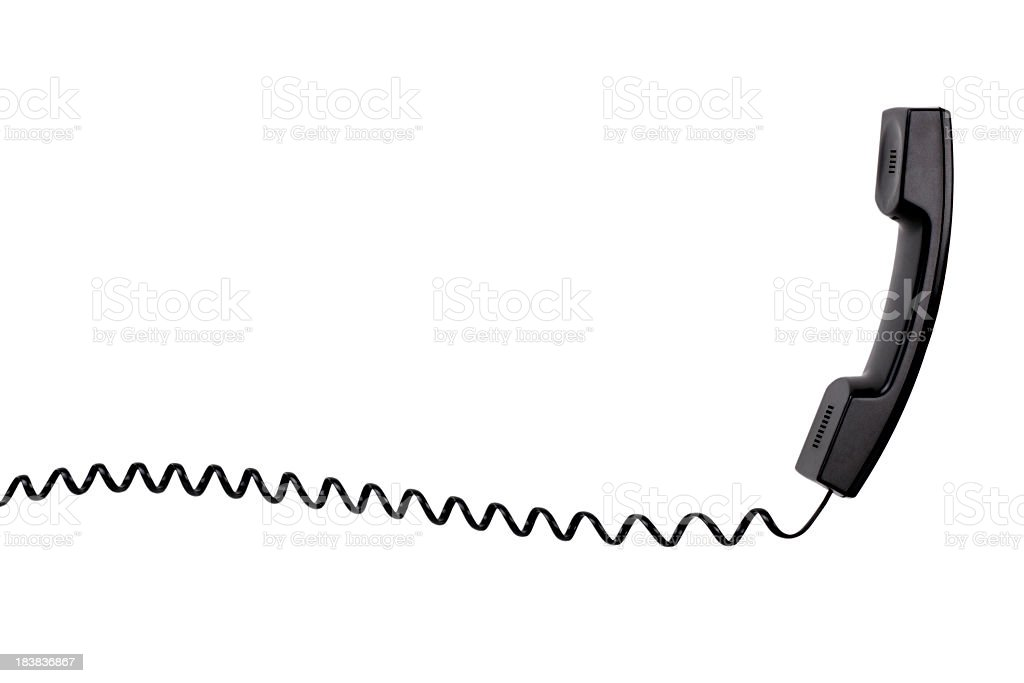 A black telephone with a spiral cord stock photo