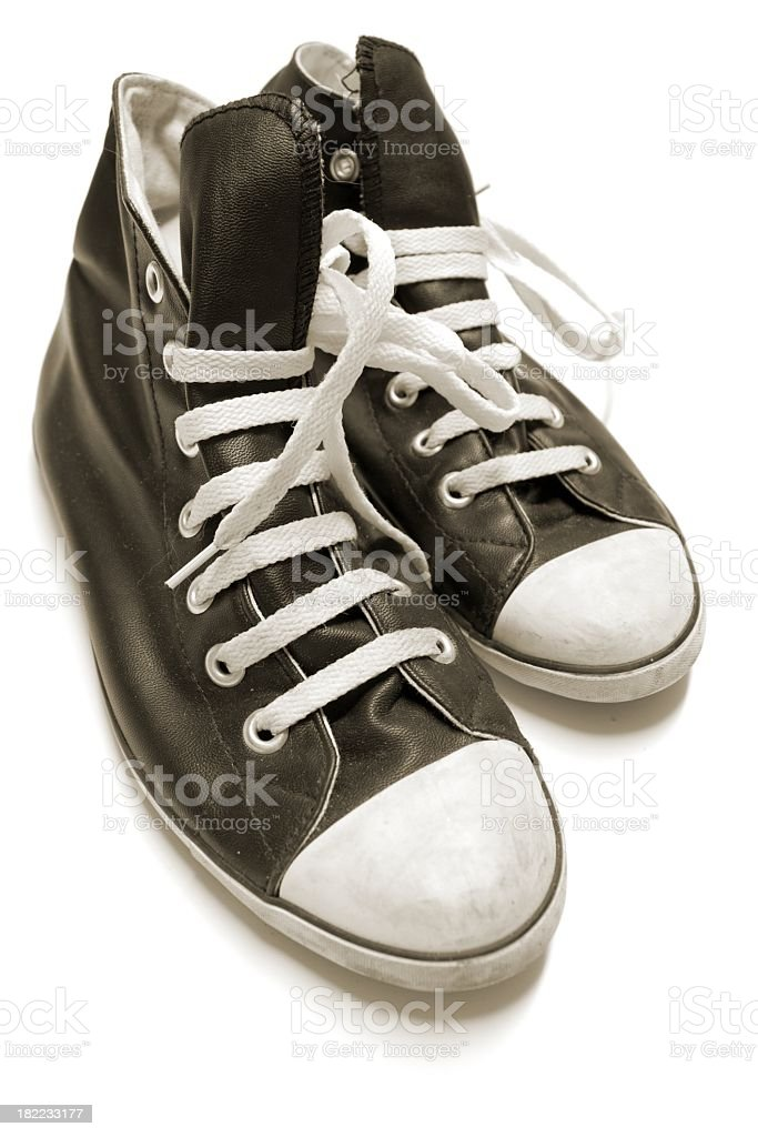 black Tennis Shoes with white lacings isolated on white royalty-free stock photo