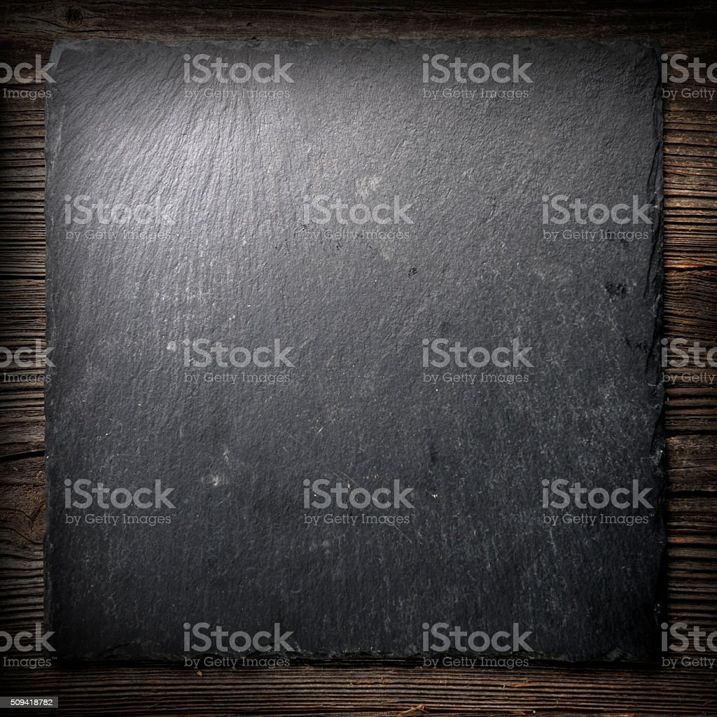 Black tile on wood stock photo