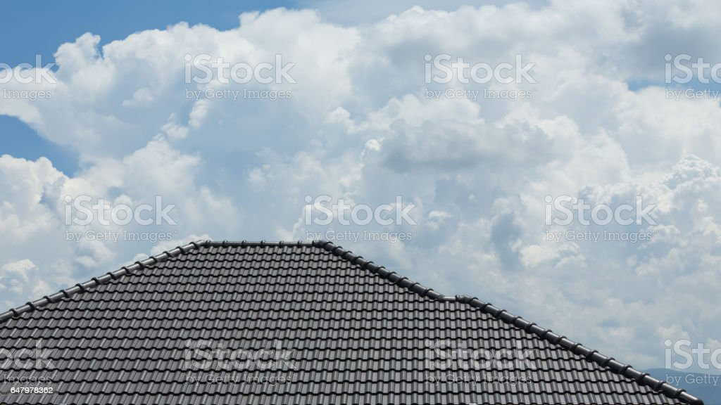black tile roof on building residence house stock photo