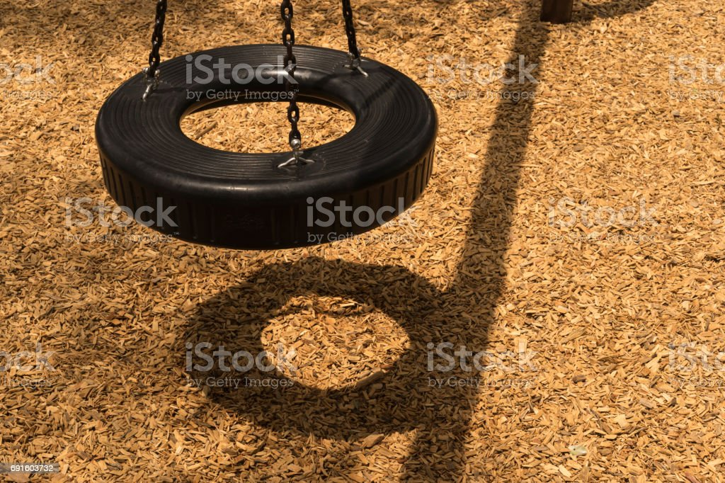 Black Tire Swing At A School Playground stock photo
