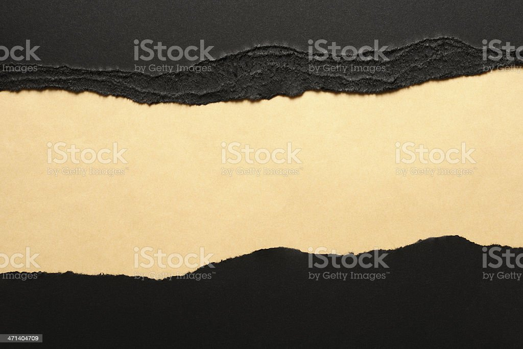 Black torn paper borders on brown wrapping paper stock photo