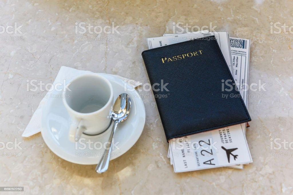 Black travel passport with flight tickets inside stock photo