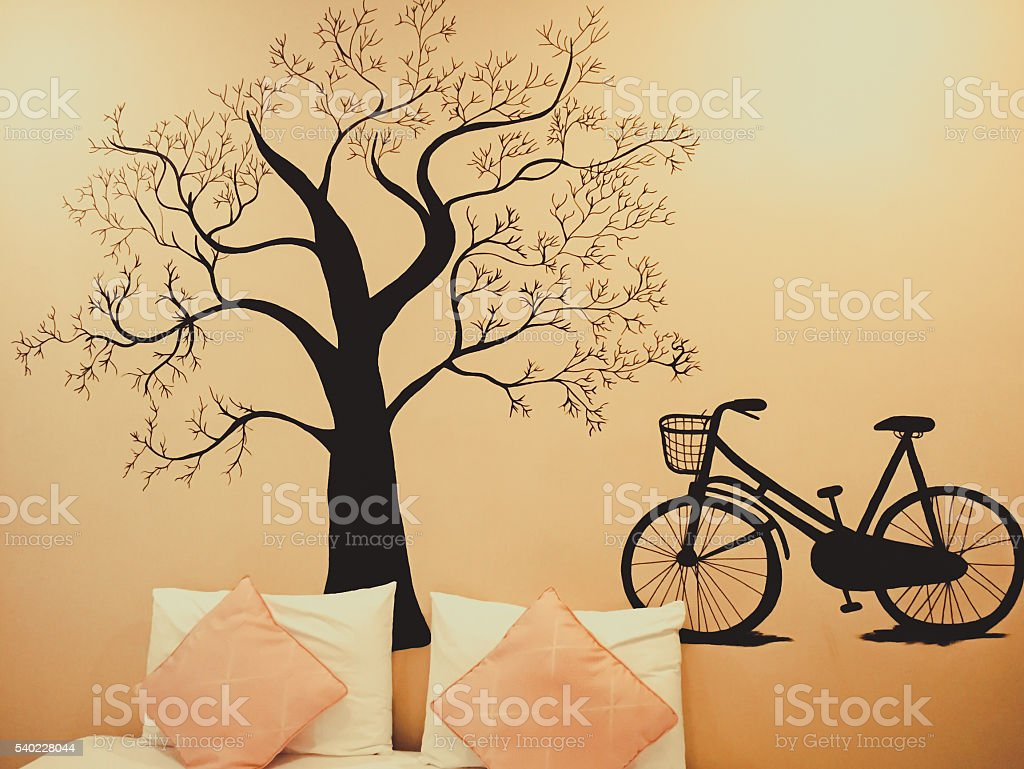 Black tree and bicycle wall sticker in the room stock photo