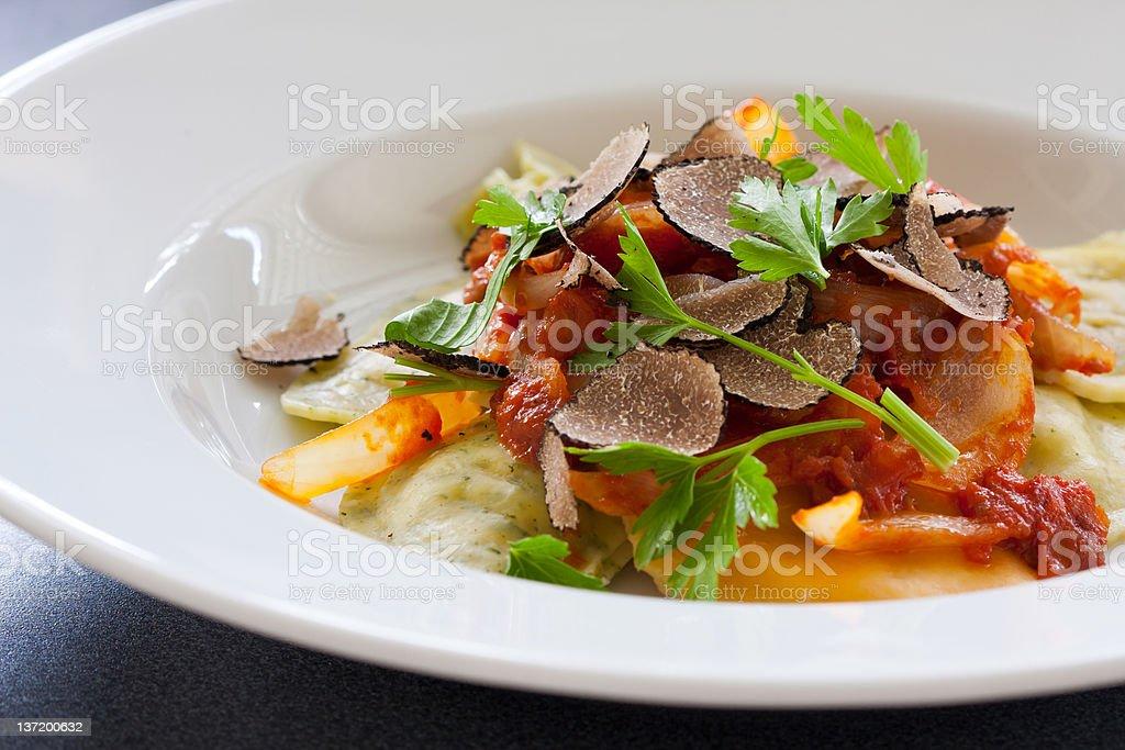 Black truffle ravioli pasta stock photo