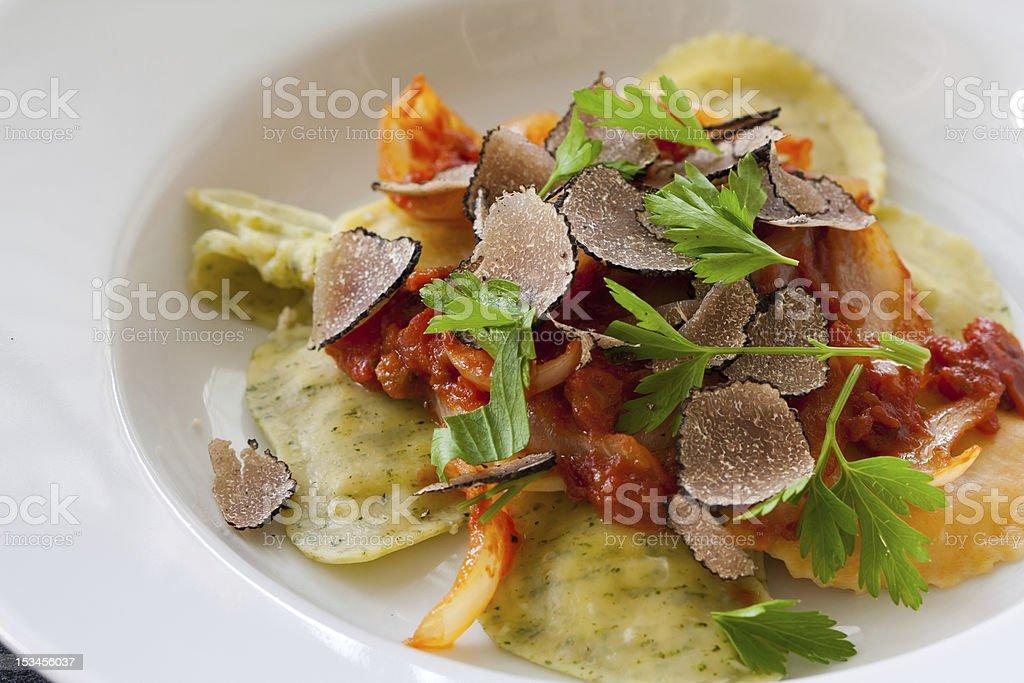 Black truffle ravioli pasta royalty-free stock photo