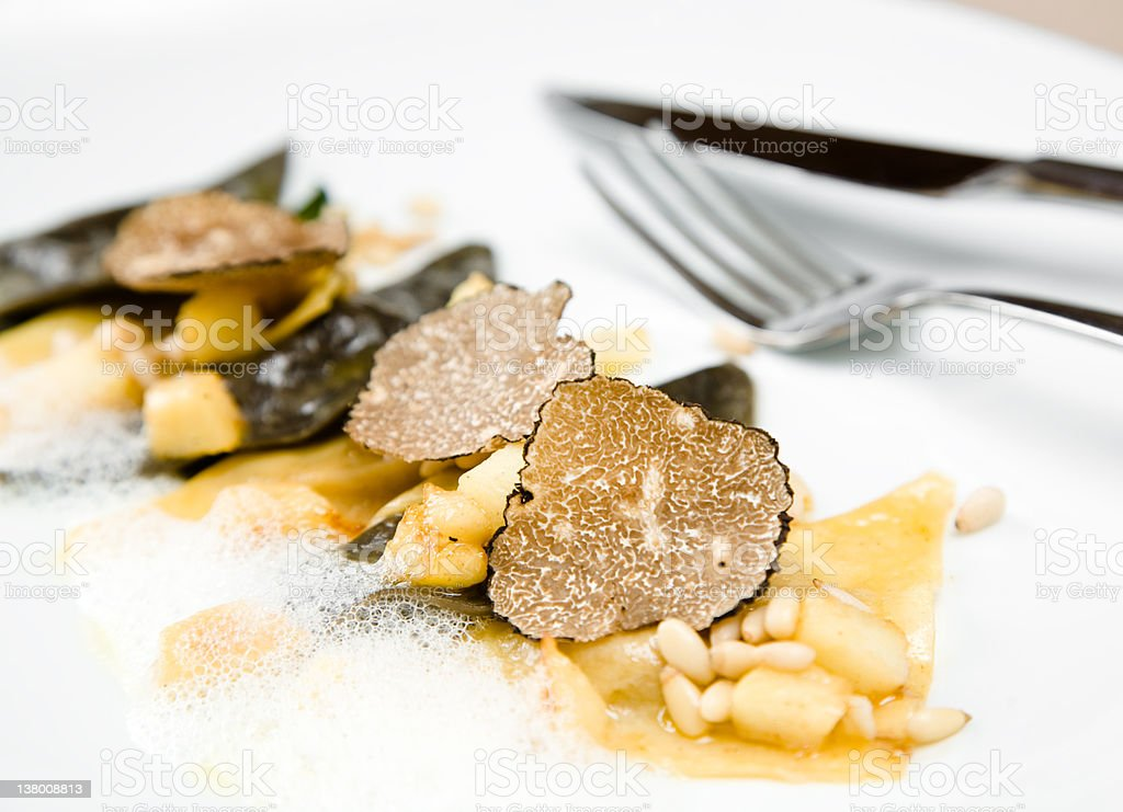 Black truffle ravioli with a fork stock photo