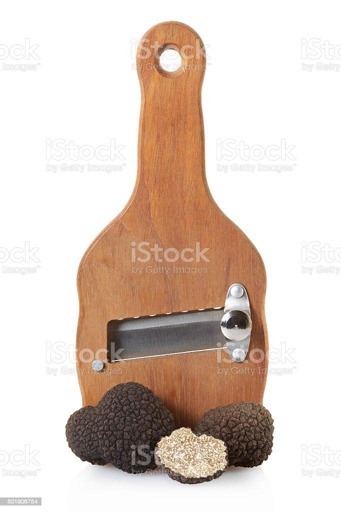 Black truffles and wooden truffle slicer stock photo