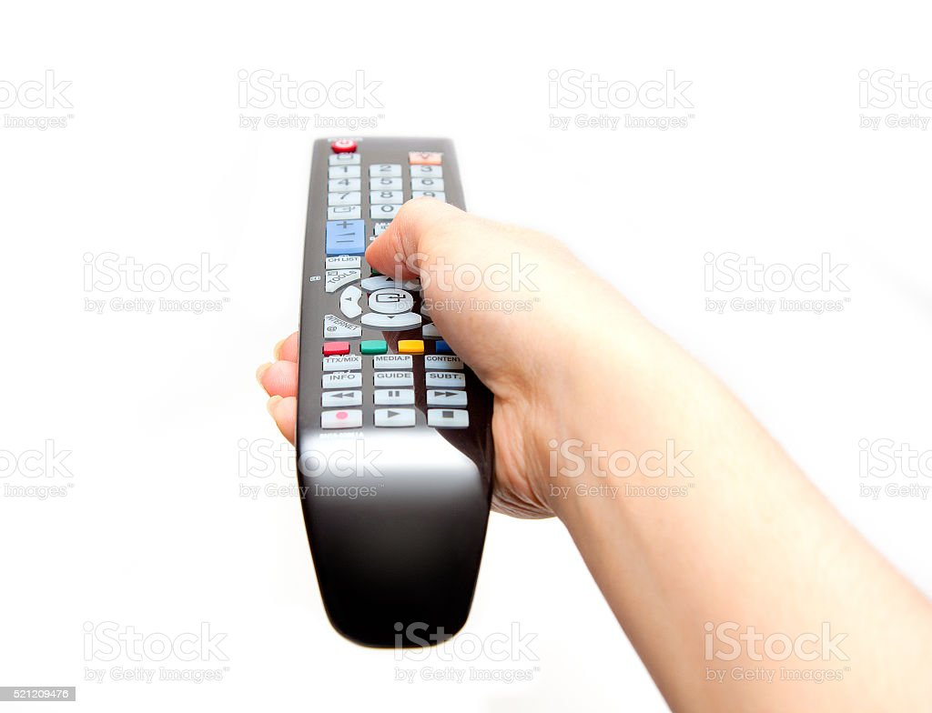Black TV remote in hand stock photo