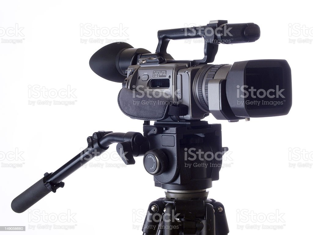 Black Video camera mounted on tripod against white royalty-free stock photo