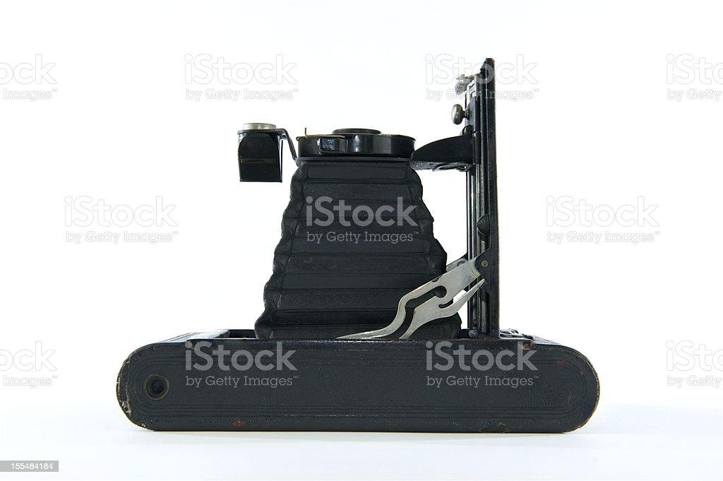 Black Vintage Folding Camera on Side royalty-free stock photo