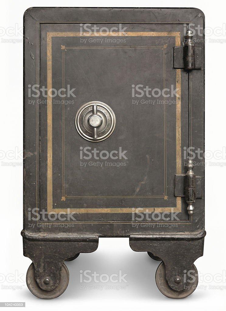 Black vintage safe on wheels with golden frame stock photo