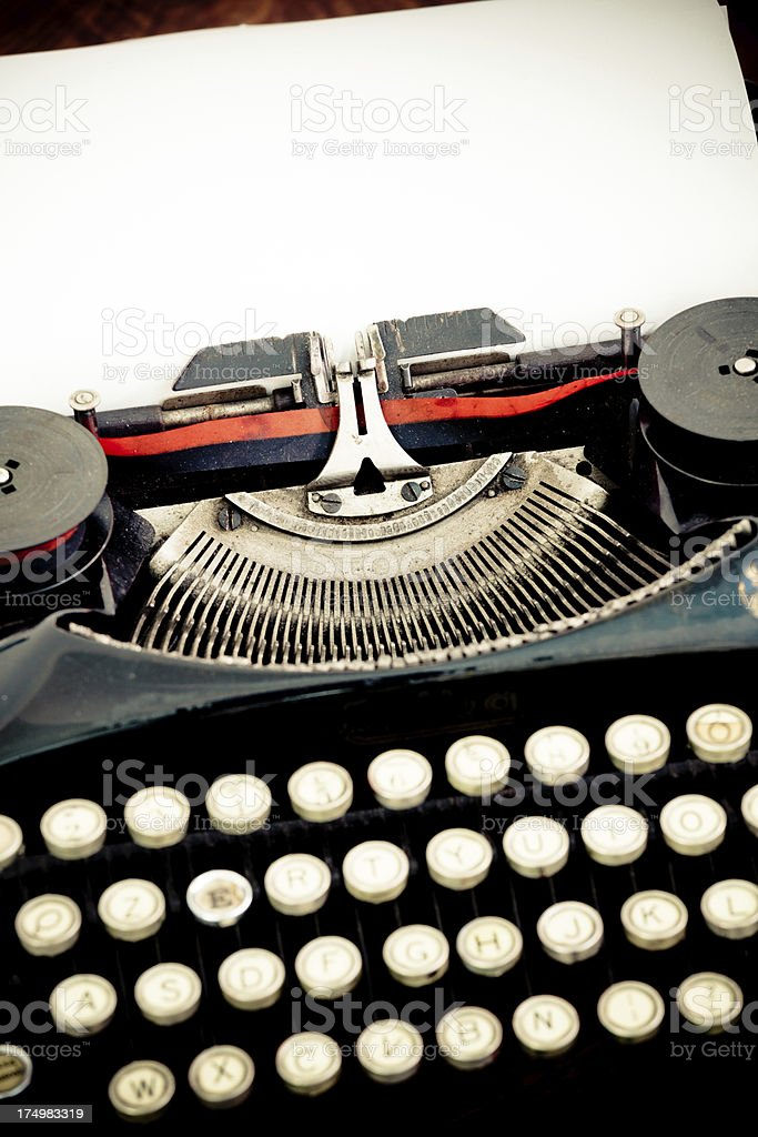 Black Vintage Typewriter and White Sheet of Paper royalty-free stock photo