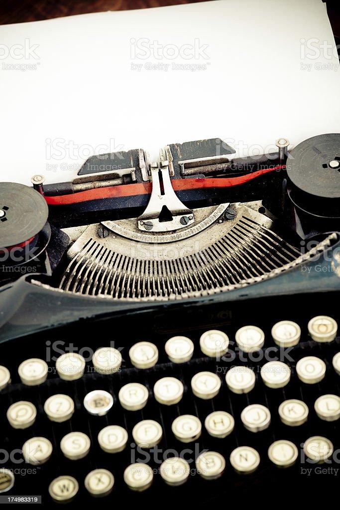 Black Vintage Typewriter and White Sheet of Paper stock photo