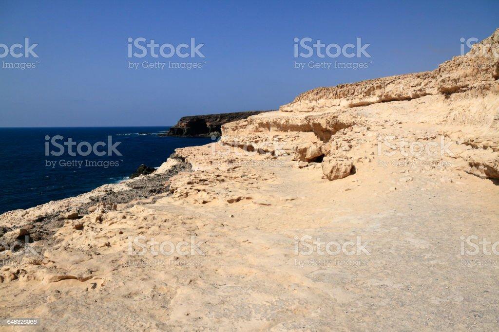 Black volcanic caves on the coast near Ajuy village, Fuerteventura stock photo