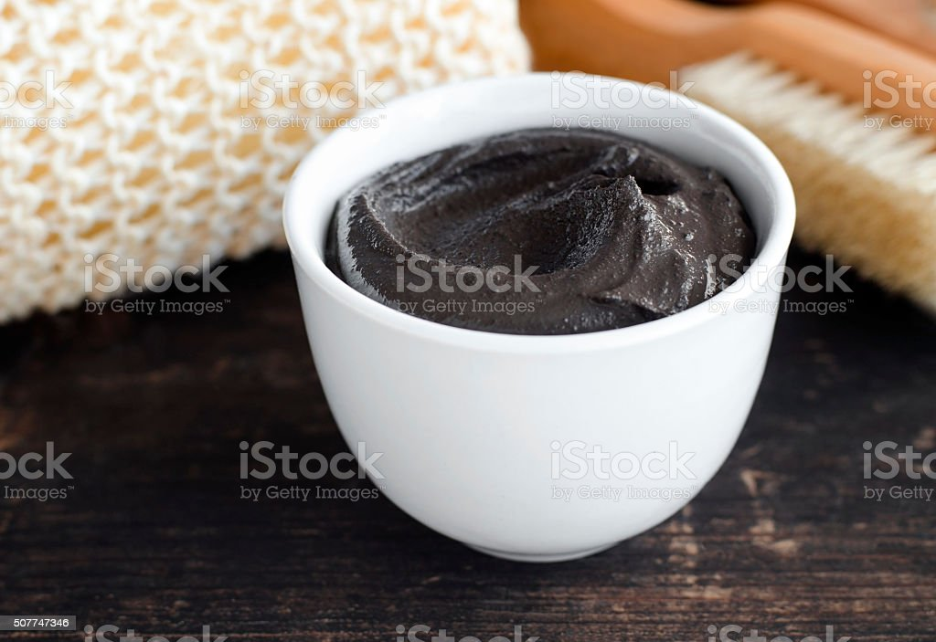 Black volcanic cosmetic clay in a bowl stock photo