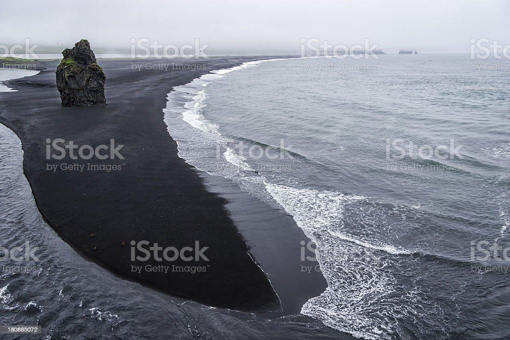 Black volcanic sand on the south coast of Iceland stock photo