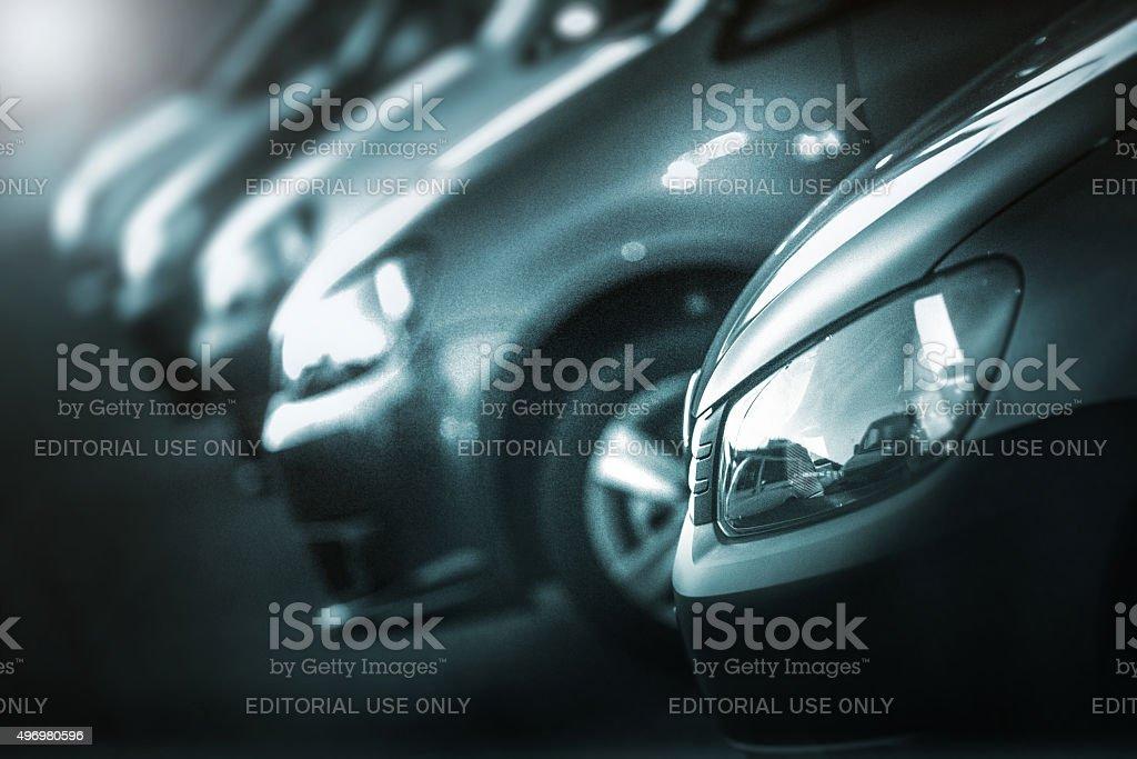Black Volkswagen vehicles on dealership at dusk stock photo