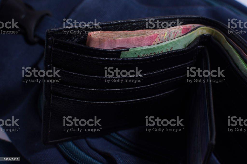 Black wallet with money baht. stock photo