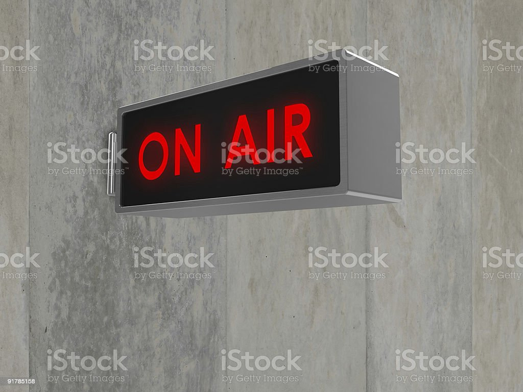 Black wall-mounted on air sign with illuminated red letters stock photo