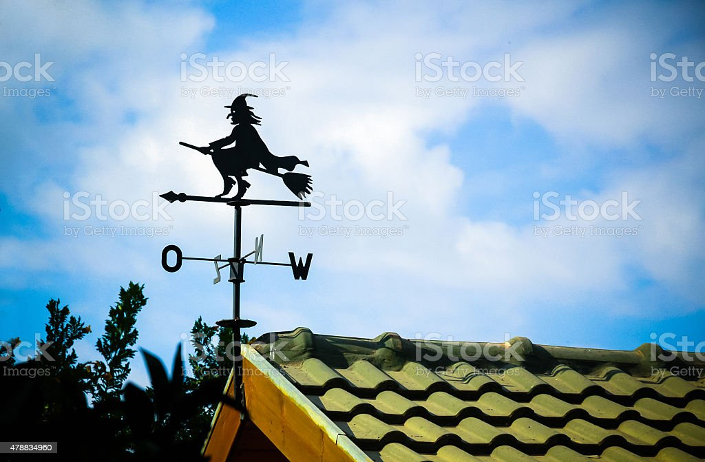 Black weathervane in the form of a witch stock photo
