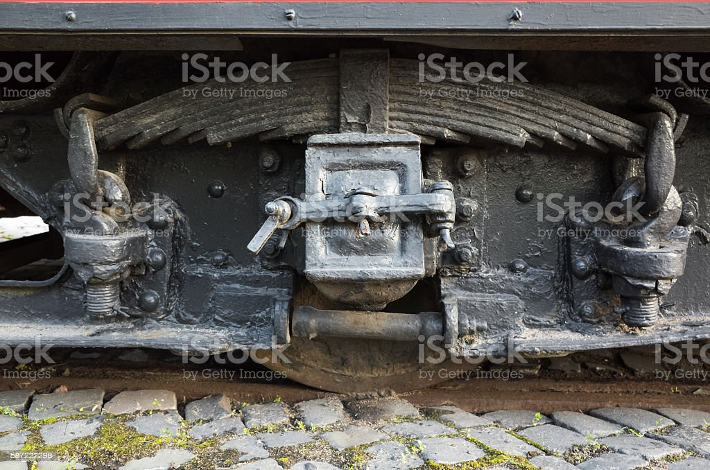 Black wheel and leaf spring of tram stock photo