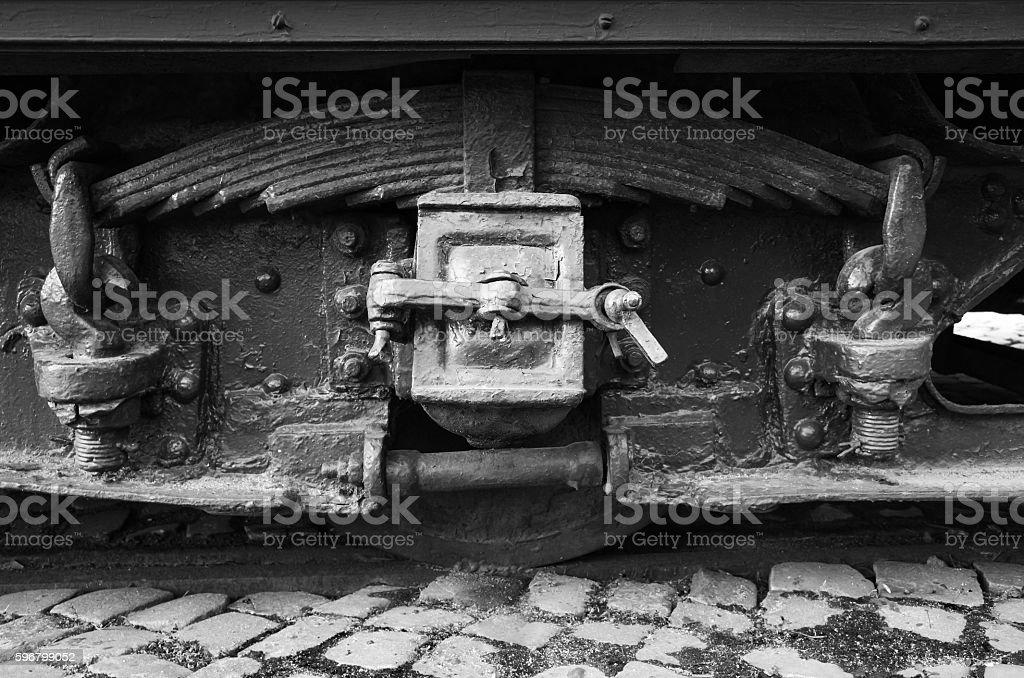 Black wheel and leaf spring of vintage tram stock photo