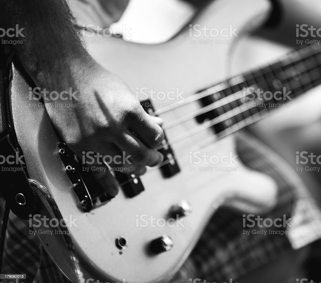 Black & white close-up of a hand playing an electric guitar royalty-free stock photo