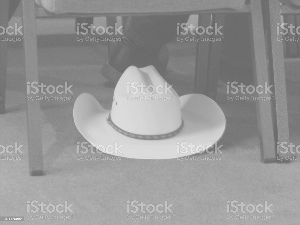 Black & White - Cowboy Hat under chair stock photo