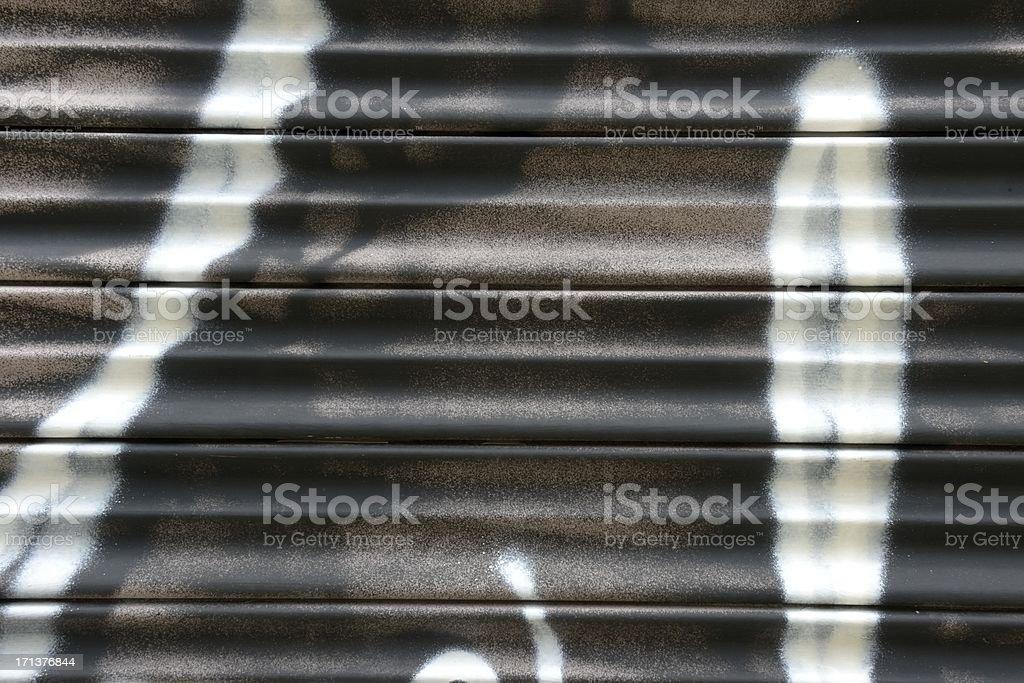 Black & White Graffiti on Metal royalty-free stock photo