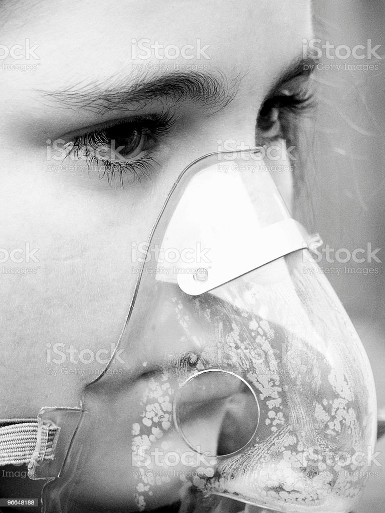 Black & White of a Child in an Oxygen Mask royalty-free stock photo