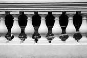 black - white photo of a plaster balustrade with balusters