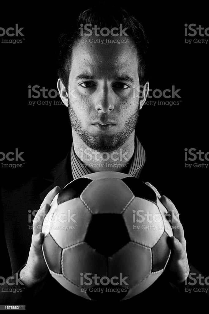 black & white portrait of businessman (manager) holding soccer ball royalty-free stock photo