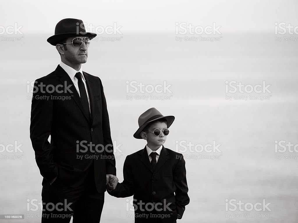 Black White Portrait Of Father And Son Wearing Similar Clothes royalty-free stock photo