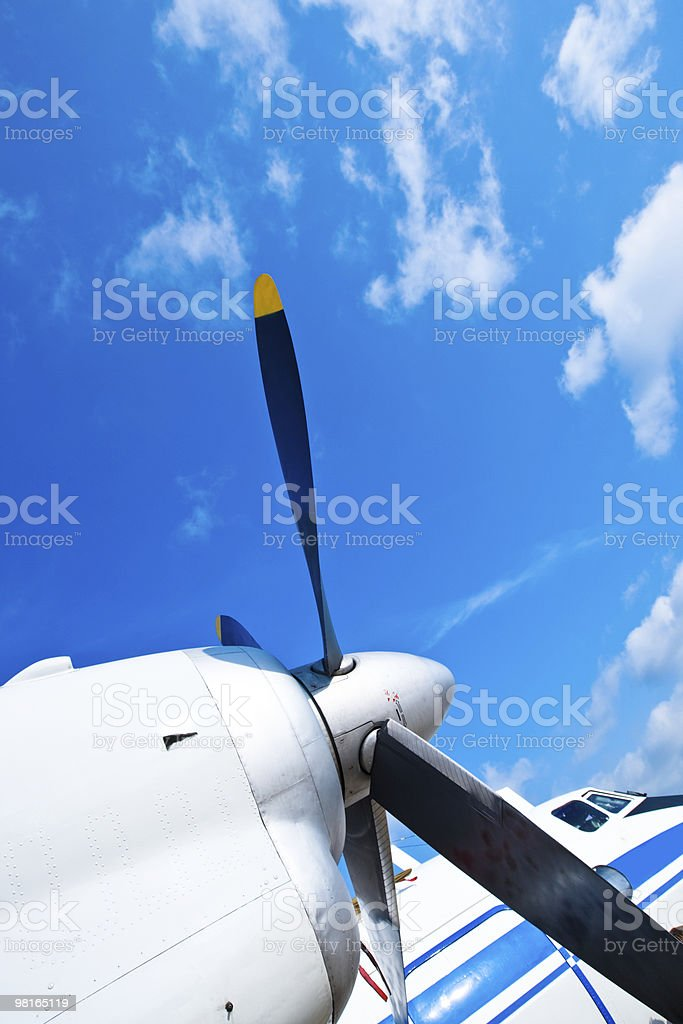 Black wings of an airplane motor in blue sky royalty-free stock photo
