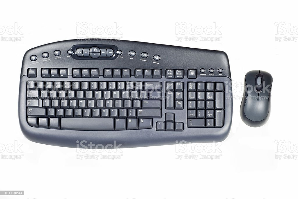 A black wireless keyboard and mouse on white background. stock photo