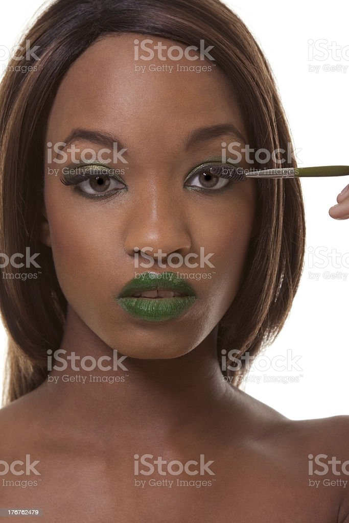 Black woman advertising exotic green makeup stock photo