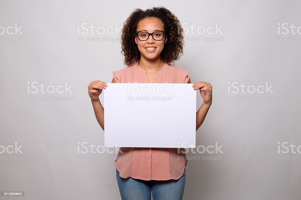 Black woman displaying white banner stock photo