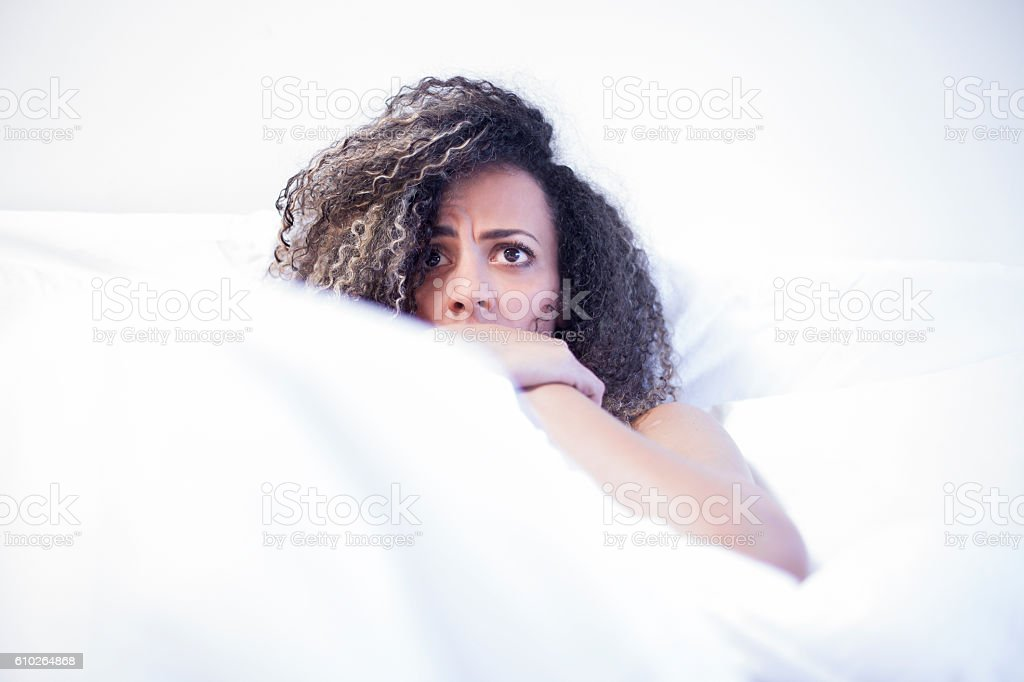 black woman gets scared watching tv stock photo