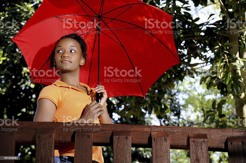 Black Woman Holding an Umbrella royalty-free stock photo