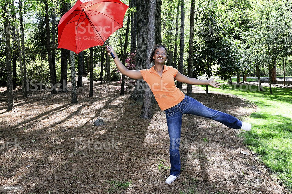 Black Woman Holding an Umbrella royalty-free stock photo