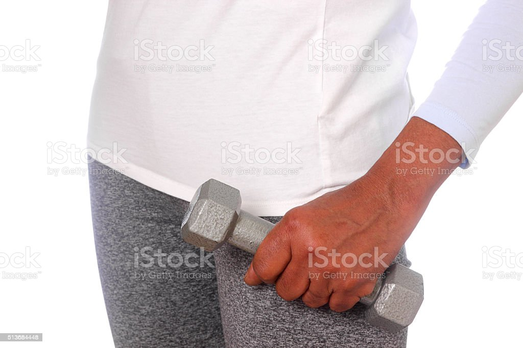 Black woman holding weight stock photo