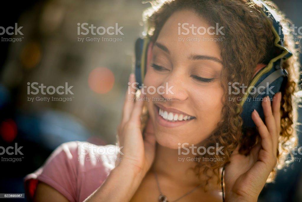 Black woman listening to music stock photo