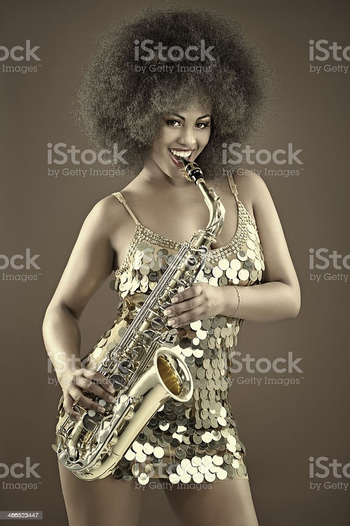 black woman playing saxophone stock photo