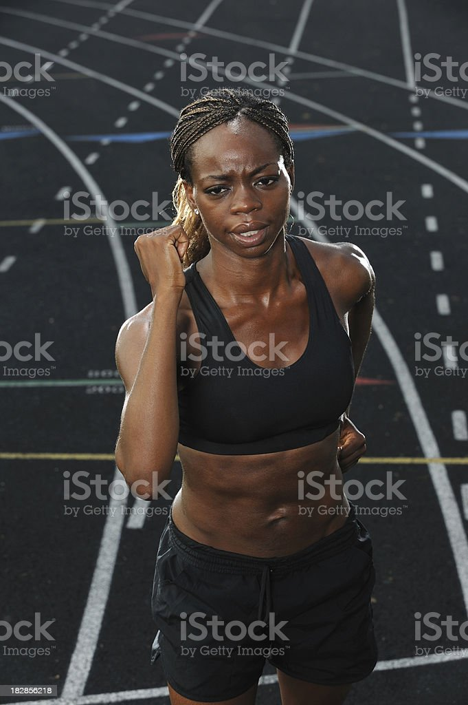 Black woman racing on the track royalty-free stock photo