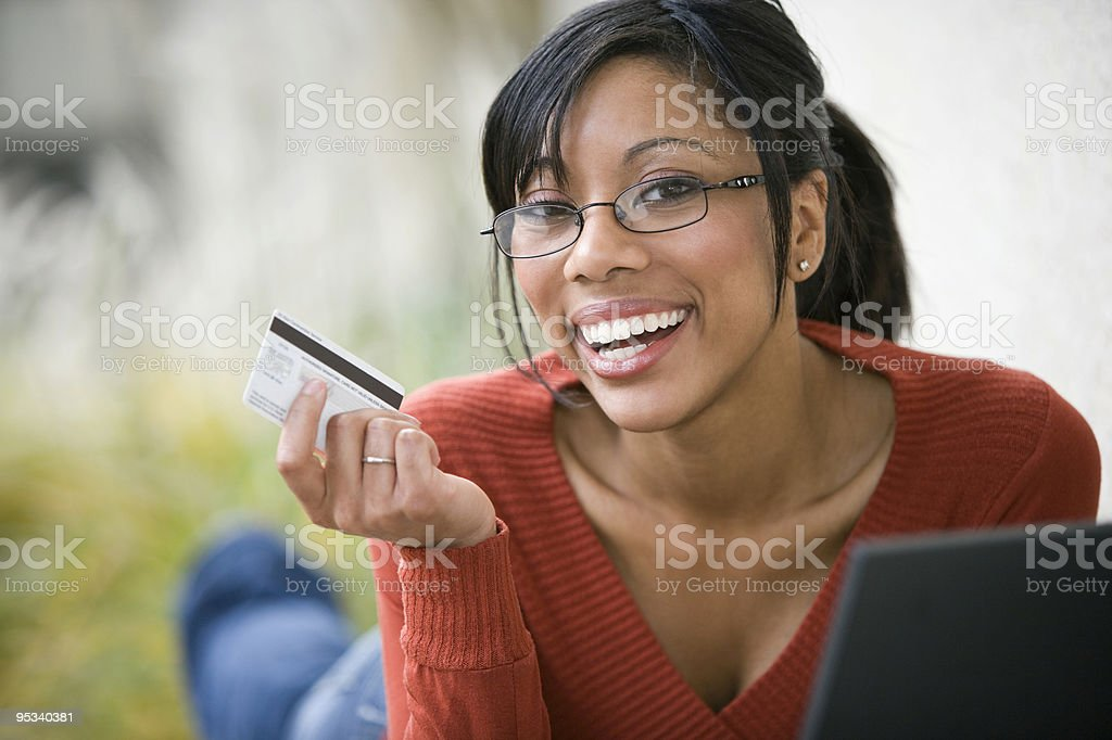 Black woman using credit card and laptop royalty-free stock photo