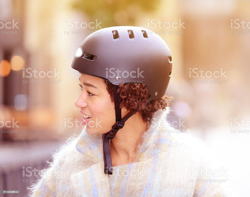 Black woman wearing bicycle helmet stock photo
