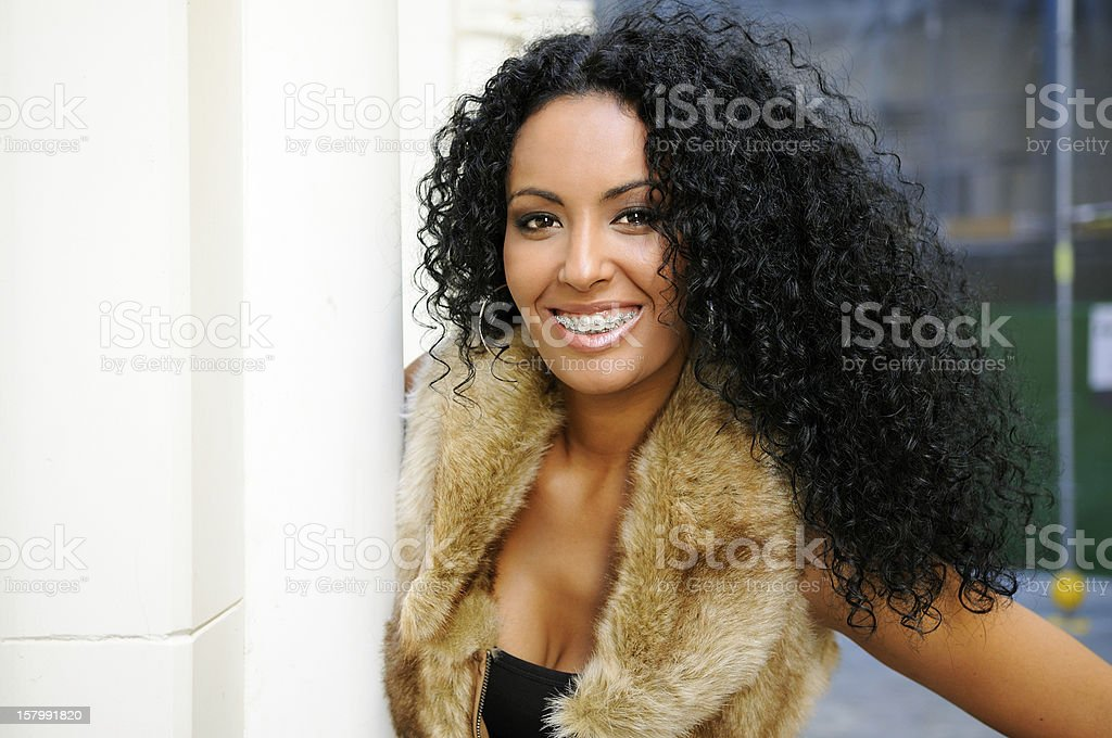 Black woman with braces and afro hairstyle stock photo