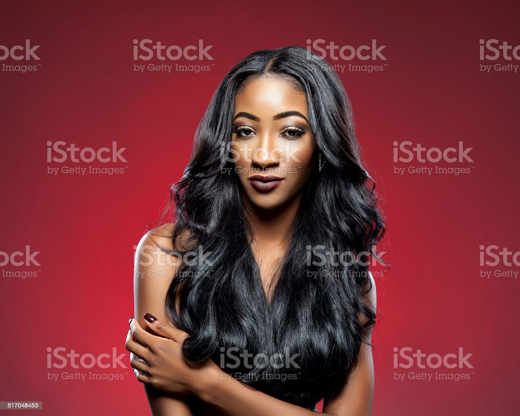 Black woman with long luxurious shiny hair stock photo