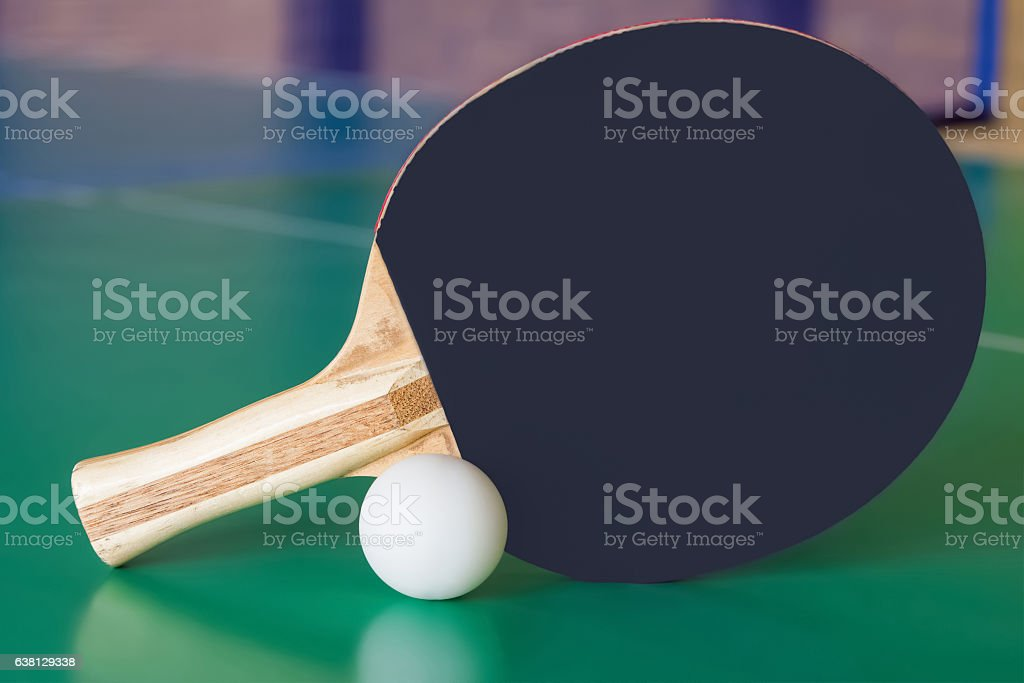 Black wooden racket for ping pong and white ball. stock photo